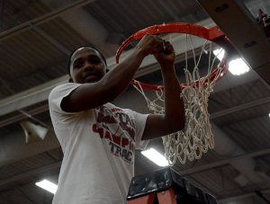 kahlil Luster cuts down the net.
