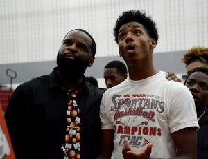 Coach Quincey Simpson and Jaleel King celebrate after the win.