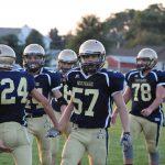 Freshmen win shortened game 12-6