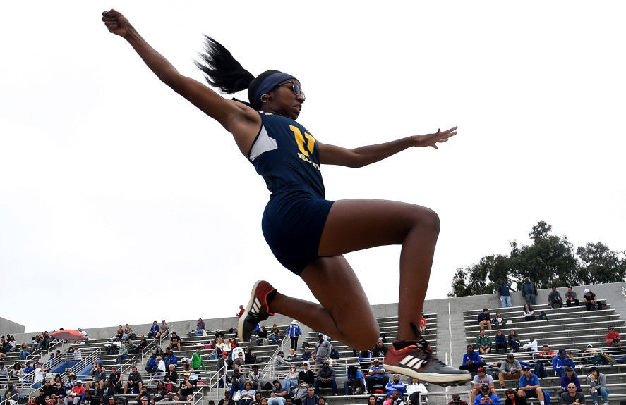 Three lady Huskies advance to Masters meet in Track