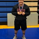 Travis Wrestling Going to State
