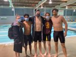 Titan swimmers break records