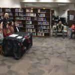 photo of bowler Emily Glover signing to Trevecca Nazarene University in the media center