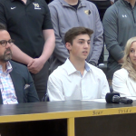 Photo of Gavin Wilson and family at his college signing press conference