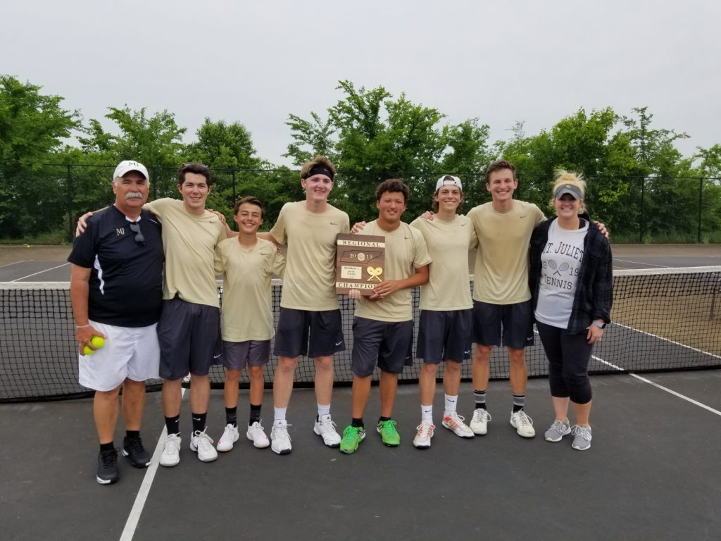 Photo of the 2019 MJHS boys tennis team holding their new Regional Champs plaque along with their coaches