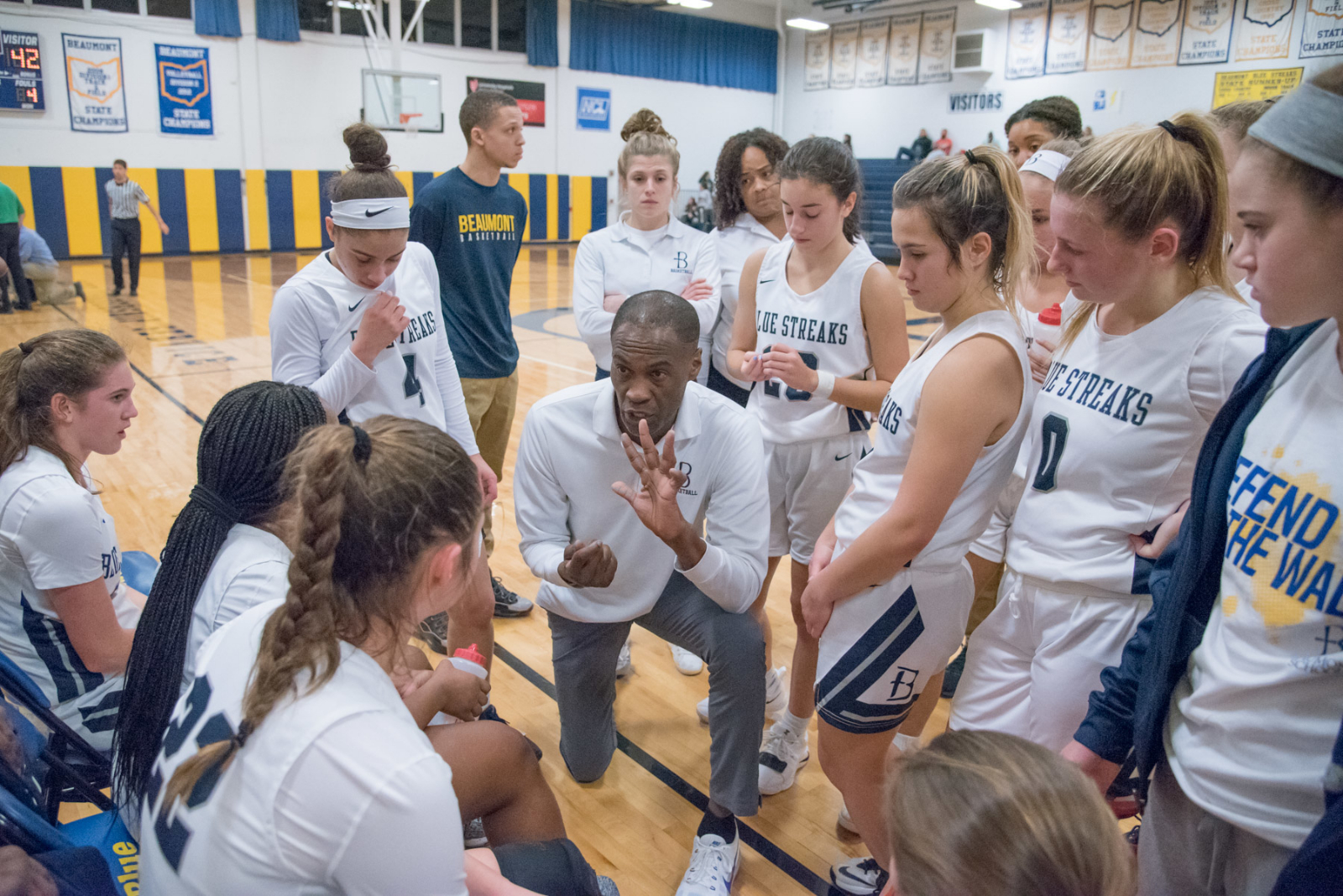 Basketball Team Concludes Regular Season with Win at Garfield Heights