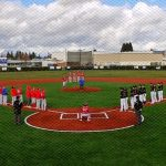 LHS varsity wins home opener after Anne Williams throws out the first pitch at the newly renovated Croco Field
