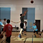 Basketball player jumping and shooting ball