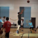 Basketball player jumping and shooting ball
