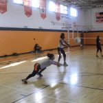 North Dallas High volleyball girls on court