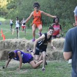 North Dallas cross country runners make the leap over haystack obstacles