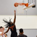 As North Dallas' Kaleb Dismuke goes to the basket, so goes his hair