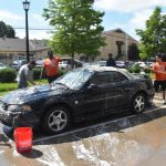 North Dallas football program car wash is successful in so many ways