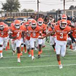 North Dallas coaches get Bulldogs ready to play on Saturday
