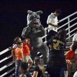 Spike the Bulldog mascot dances in the stands, poses for photos