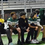 Spence and Rusk players pose for photo, watch on sidelines of North Dallas football game