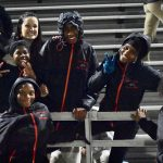 Even in the cold wet rain, the North Dallas student trainers assist on the sidelines