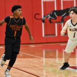 North Dallas junior varsity  team runs into Hillcrest press