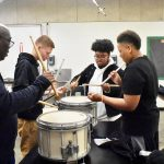 Learning from a pro, North Dallas band drummers work on their craft