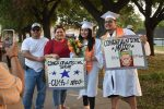Family, friends cheer the North Dallas seniors with signs, but don't ask for their last names