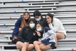 Lady Bulldogs soccer players show support for boys team