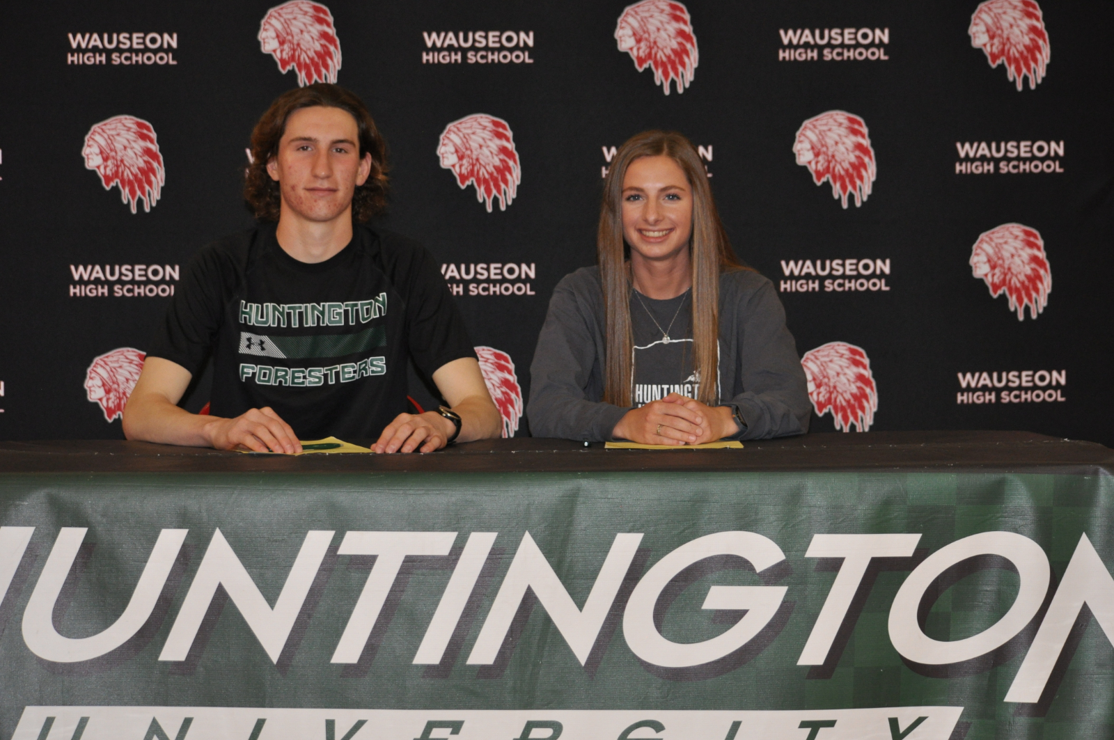 Cheezan and Richer sign with Huntington