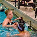 Boys Varsity Swimming beats Waconia 98 – 82