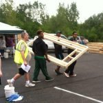 Habitat for Humanity gets help from Football players