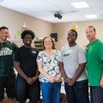 Football Team volunteers in Free Food Distribution Program