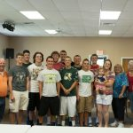 Football seniors participate in the Free Food Distribution Program