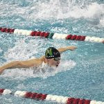 Swim teams compete in district meet