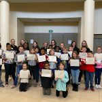 Mrs. McCarroll's 4th Grade class finishes Financial Literacy Lesson at High School
