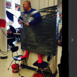 Coach Styes Sticks To A Wall For Charity