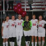 Seniors Lead White Hawks in Win Over Delano