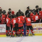 Boys hockey team huddle