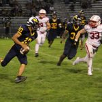 Stout Defense Moves White Hawks to 4-0 in Win at Bloomington Kennedy