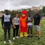 Varsity Football players volunteer at Running Springs Elementary