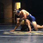 Wrestling finishes off league with a win