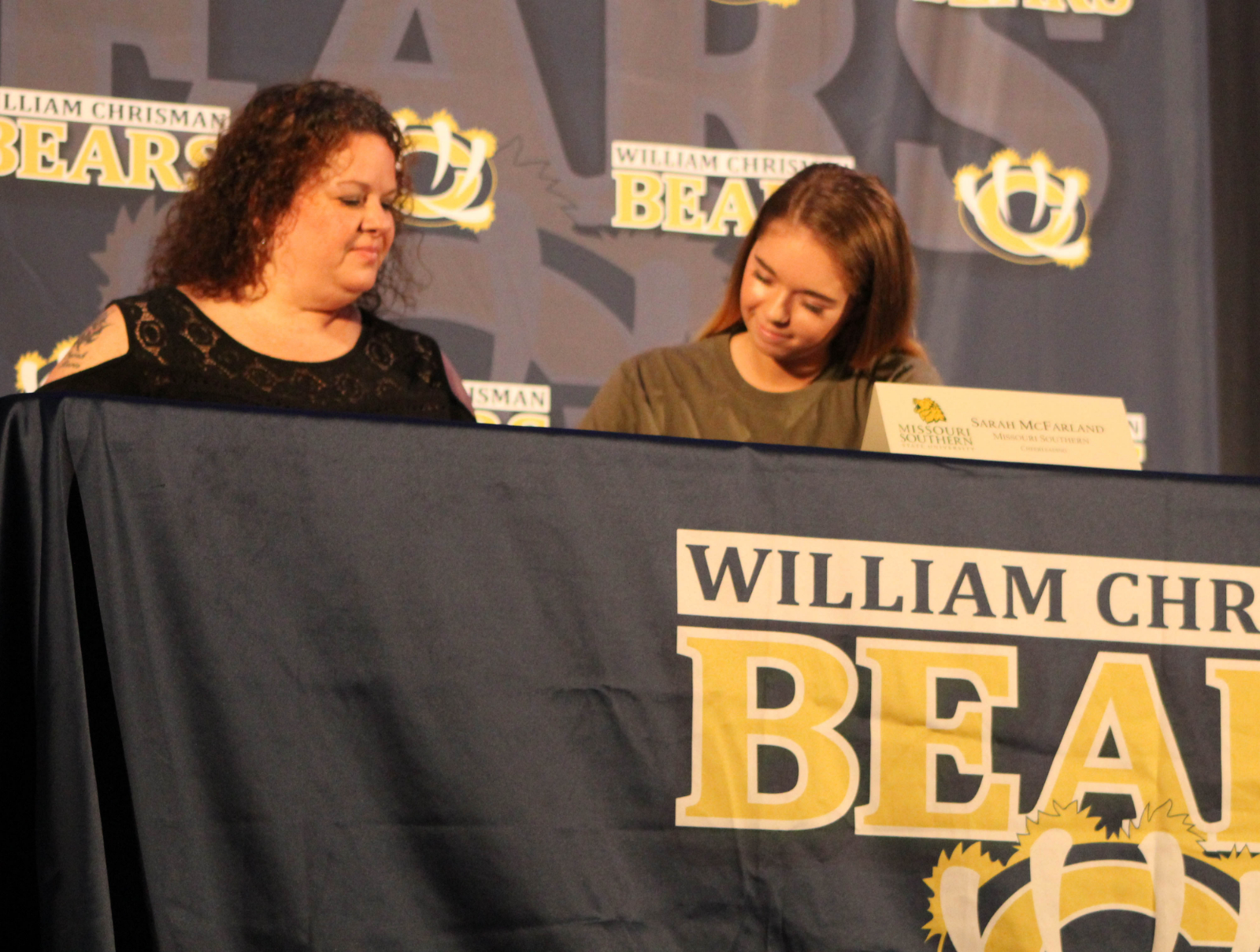 Two Chrisman Cheerleaders Sign to Continue Cheering at Next Level