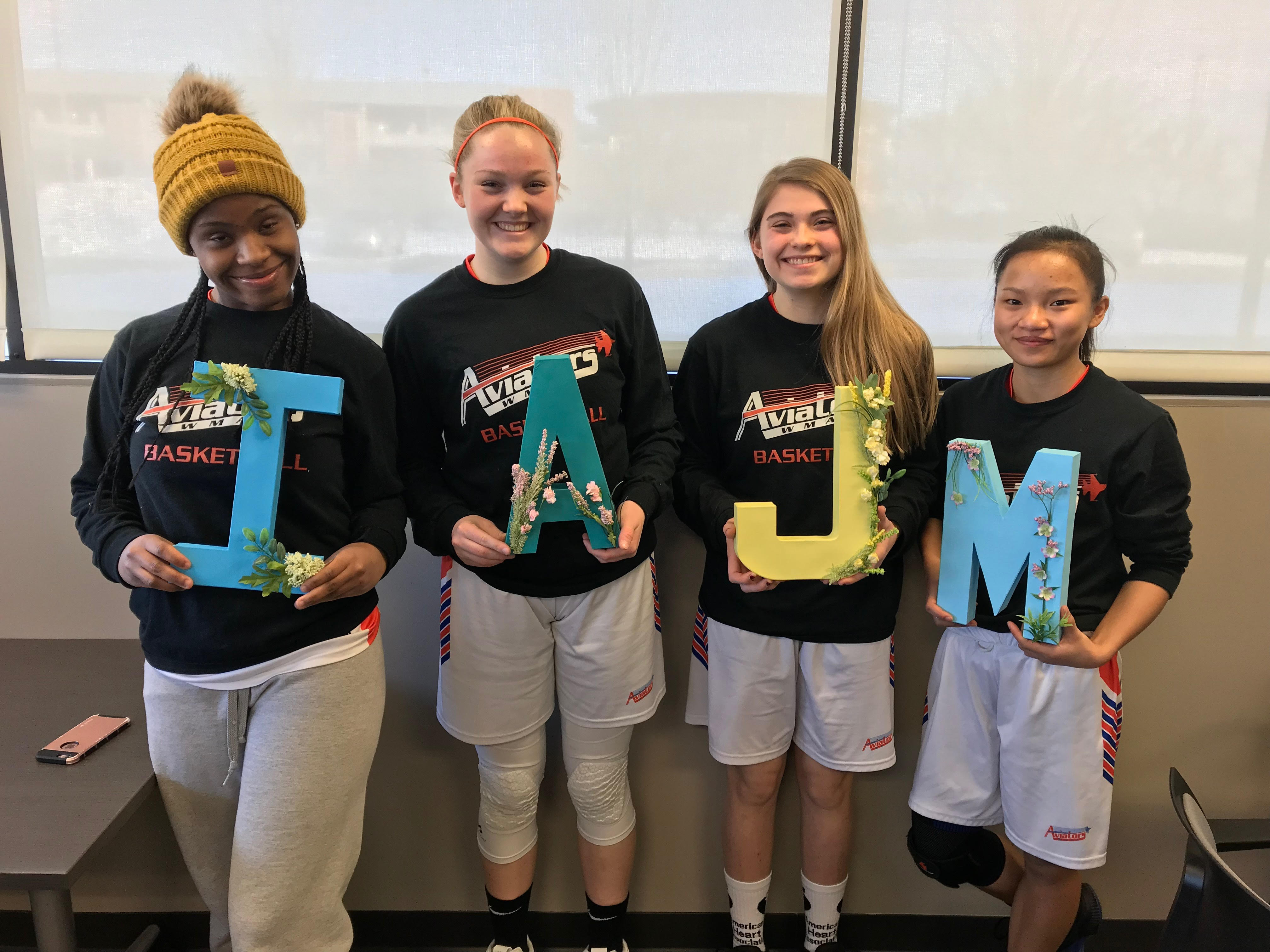WMAA girls basketball seniors record victory in final game on their home floor