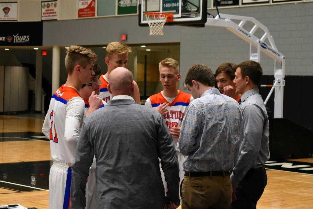 WMAA Boys Varsity Basketball team wins home opener 65-34 over Fruitport Calvary