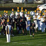Varsity Football Scores First Win