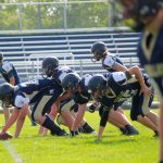 Freshman Football Squeaks Out Win Over Petoskey