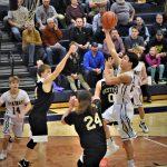 Boys Basketball Sweeps Bay City Western