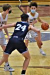 Boys Basketball Beats Reed City in Opening Round of Districts