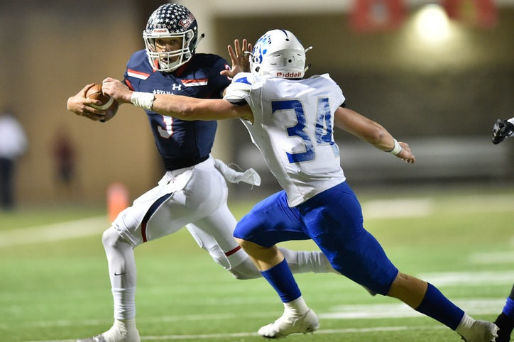 Football: After slow start, Ryan rolls past Brewer in playoff opener