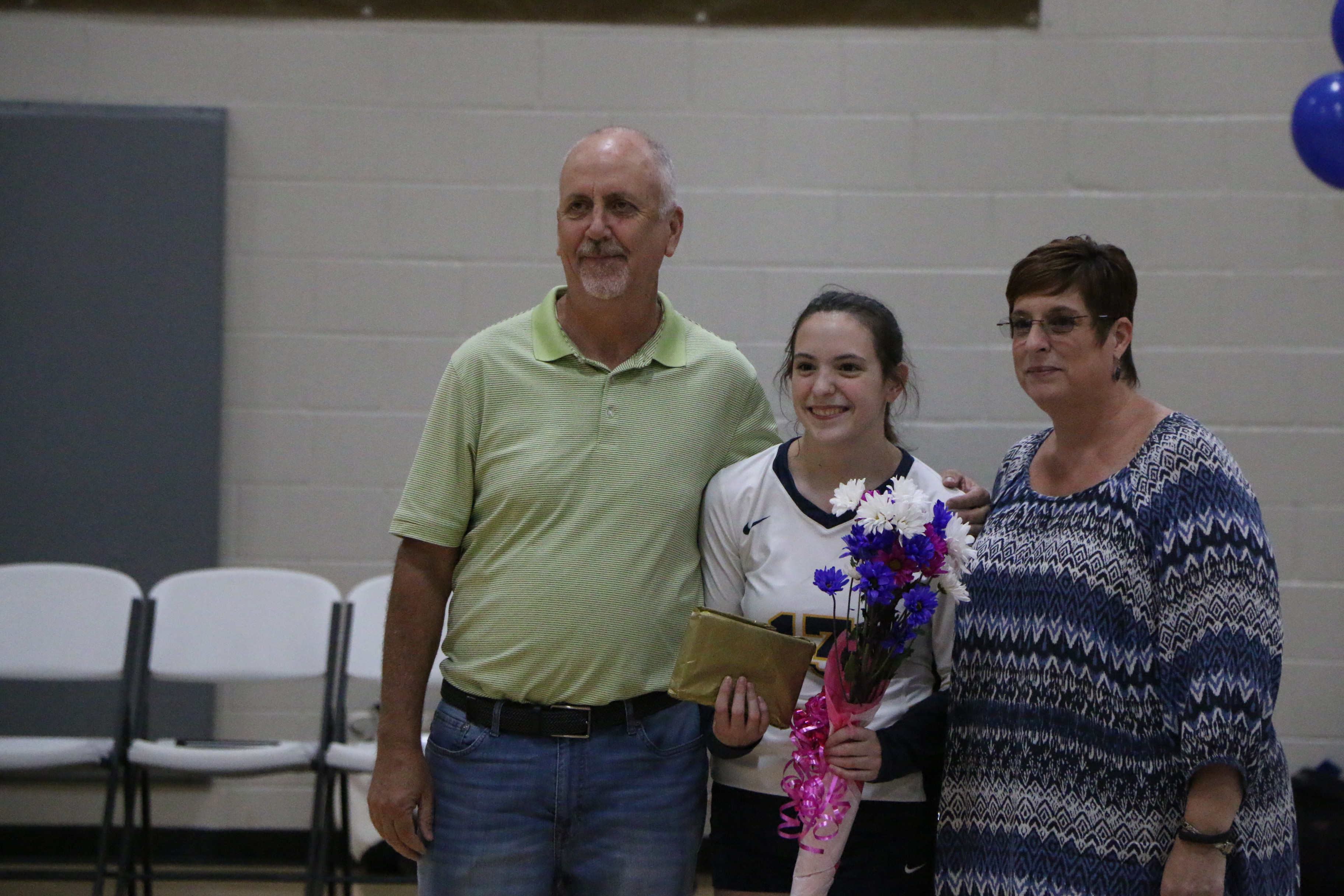 Beth Dickerson honored at Volleyball Senior night.
