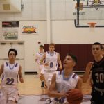 Boys Varsity Basketball beats Lowell 64 – 61