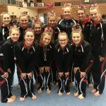 Girls Varsity Gymnastics finishes 8th place out of 16 at Rockford Flip Flop Invite