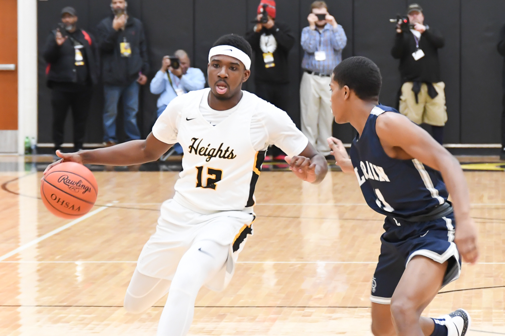 HEIGHTS BOYS BASKETBALL – Tigers pull away in second half for win at Warrensville